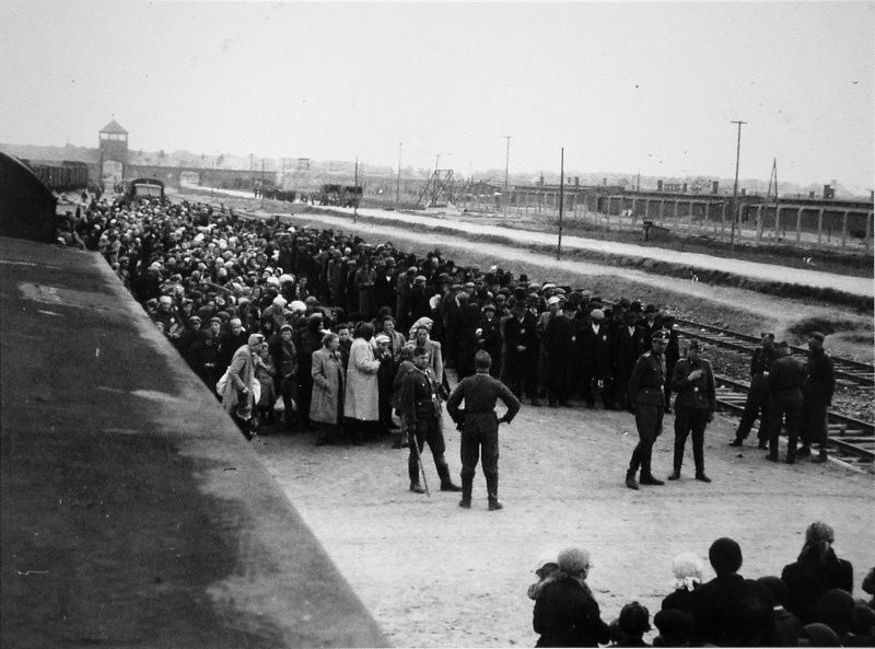 The arrival of the prisoners in the concentration camp Auschwitz. The first stage of selection. It was necessary to divide the prisoners into two columns, separating men from women and children.