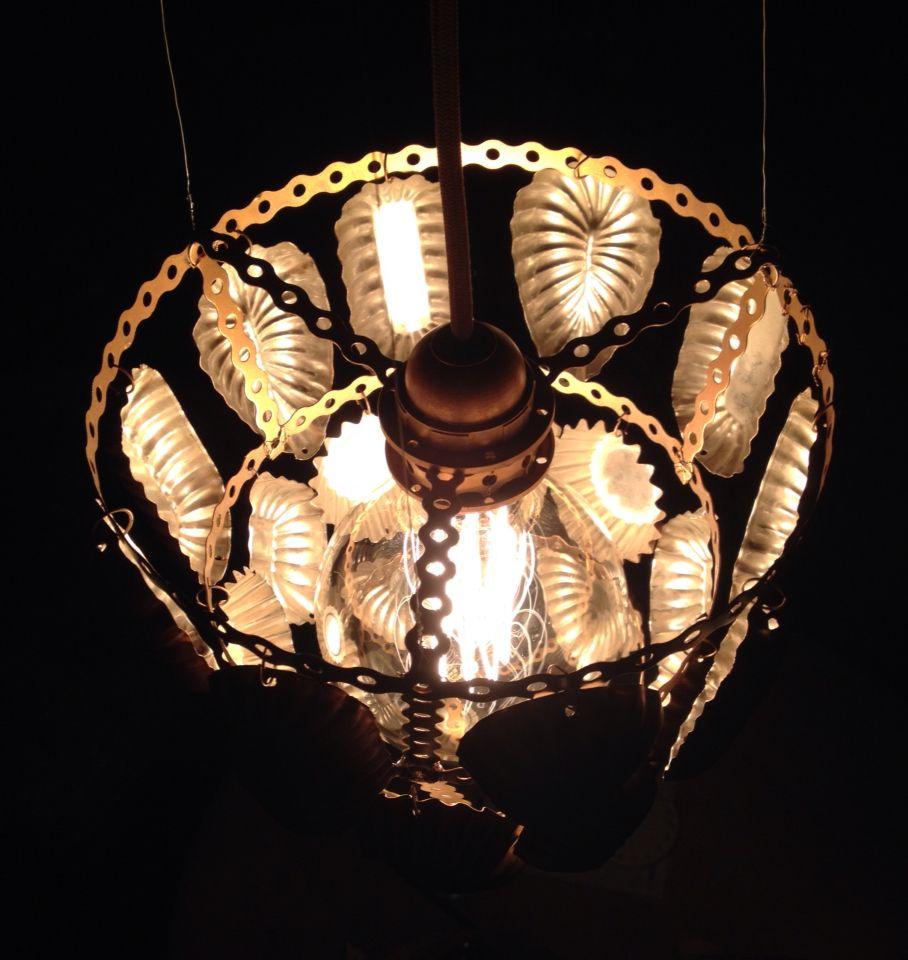 Redesigned by Vicky Maria Hvidsten. Lampe av sandkakeformer. Lamp of sand cake tins.