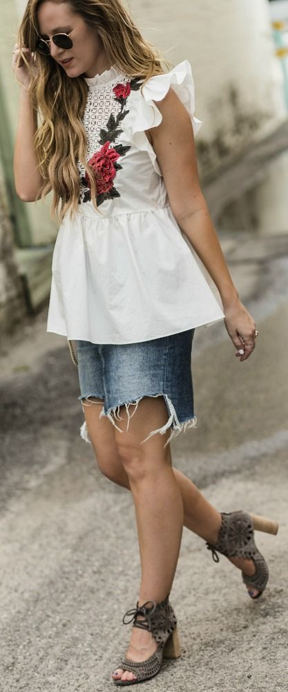 62fba66e5 Cute date night outfit styled with embroidered and ruffle peplum top,  distressed denim mini skirt, lace up suede block heels, and Chloe Faye dupe