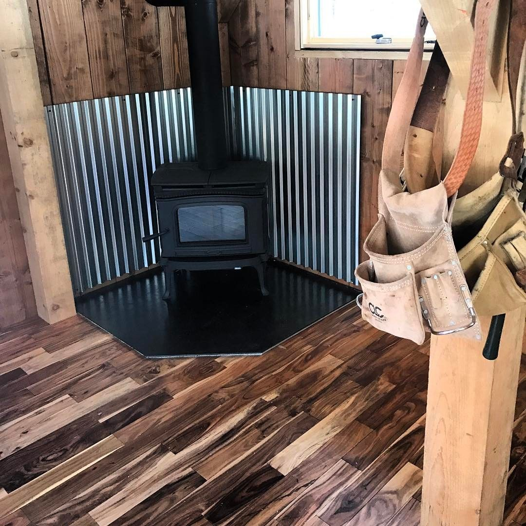 Oh And The Wood Stove Is In Pacific Energy T4 Looking Classy Af With The Flooring Choice And The Corrugate Wood Stove Wall Diy Wood Stove Wood Stove Decor