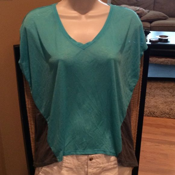 """Softest T Ever Very sheer. There is no tag with brand or size. Good condition with one snag in the back shown in pictures. 19"""" in front and 22"""" in back  21"""" across Tops"""