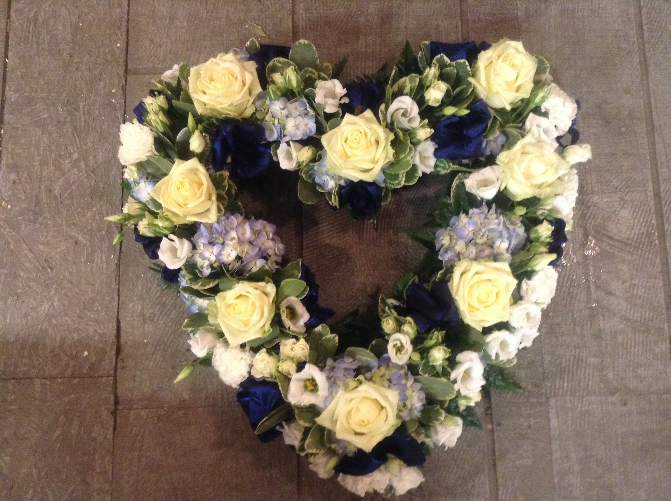 Heart of flowers pale blue hydrangea cream roses navy silk ribbon heart of flowers pale blue hydrangea cream roses navy silk ribbon izmirmasajfo Images