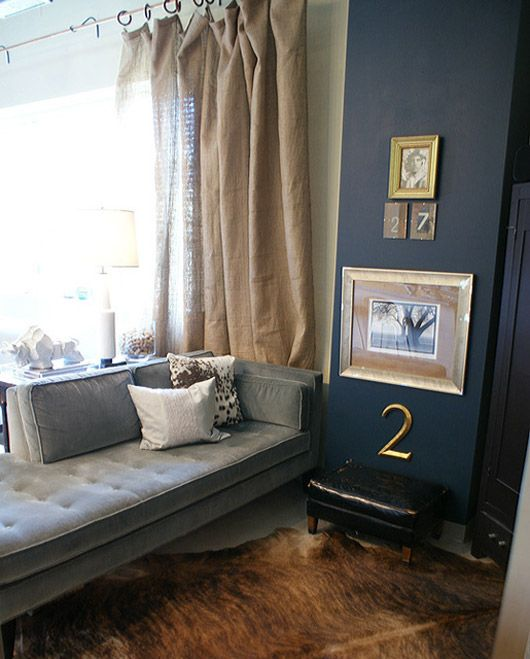 gray couch, black wall, dropcoth curtains, black and gold touches ...