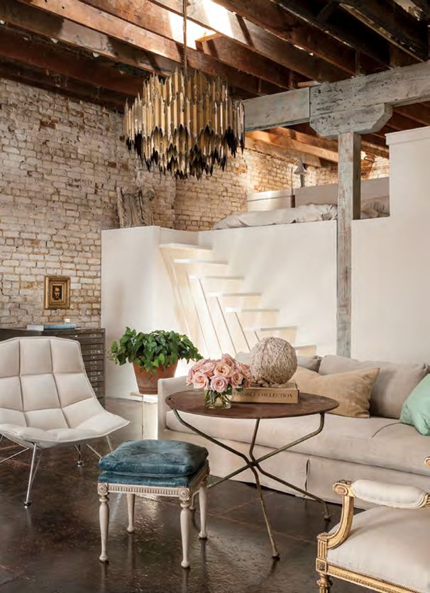 Aaron Rambo's Houston loft love it all...Concrete floors, exposed brick, beams..