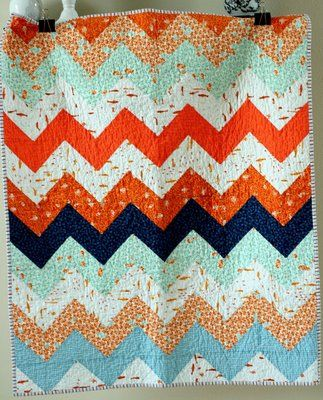 blue and orange zig zag quilt. Very cute!