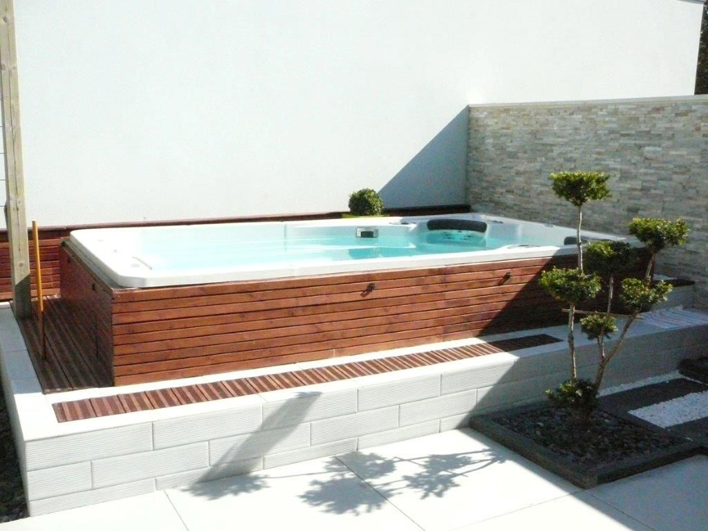 hydropool self cleaning swim spa installed in a wooden enclosure