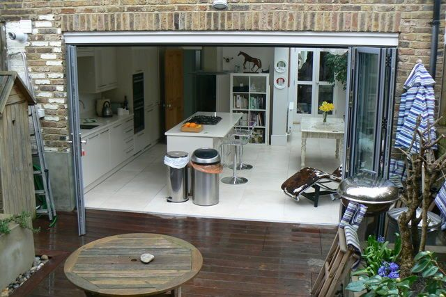 I had thought about having the kitchen by the windows in this sort of layout - what you think?