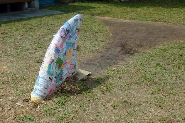 Paper-mache style, this shark's fin zooms through the patch of grass in the courtyard towards on-coming visitors with absolutely no warning.