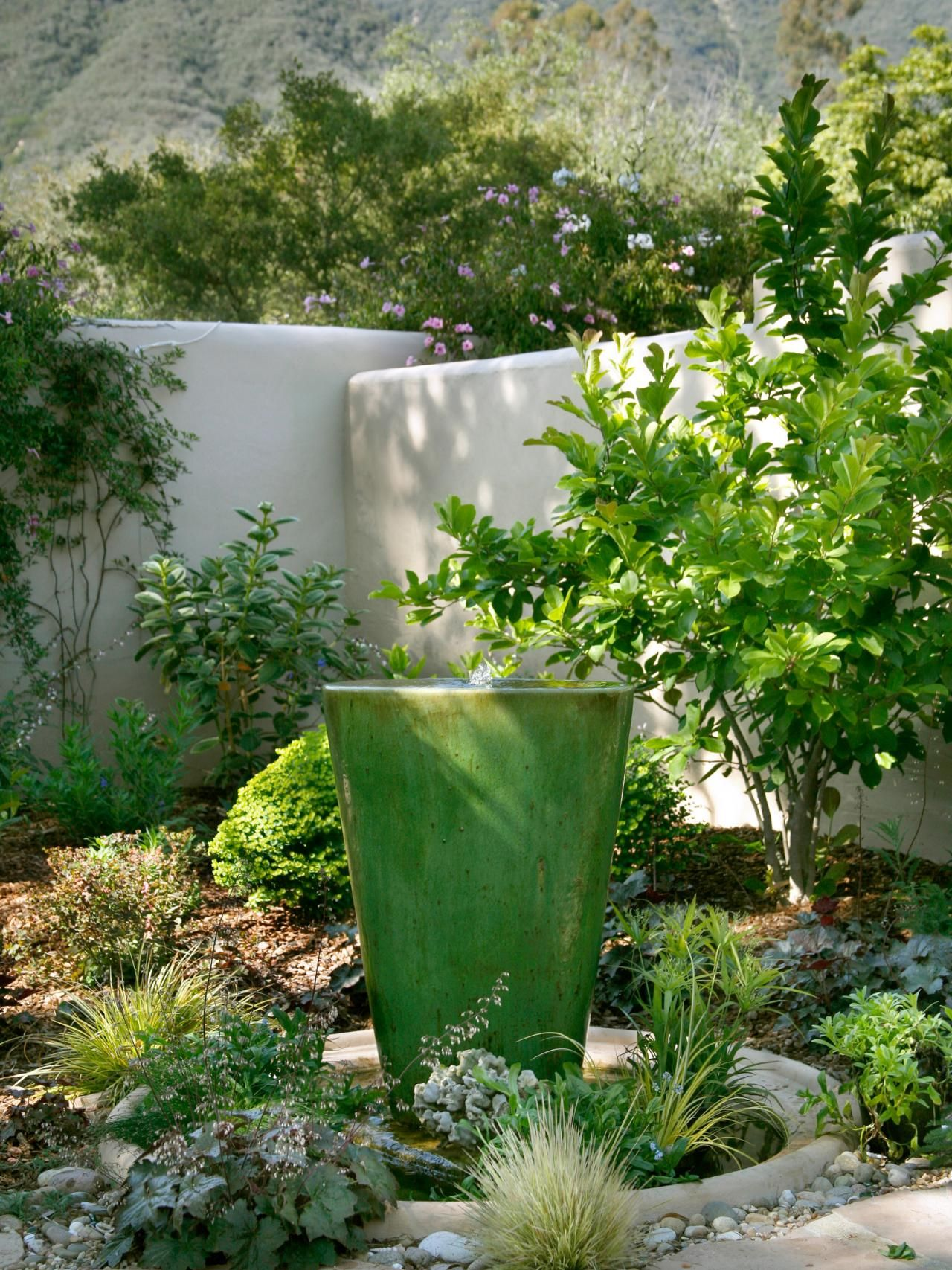 A bubbling green water fountain creates a soothing ambiance in this ...
