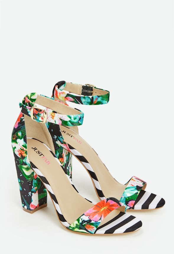 c27b8ce427f5 These high heeled sandals feature a striped block heel and ankle strap  closure with a floral print open toe