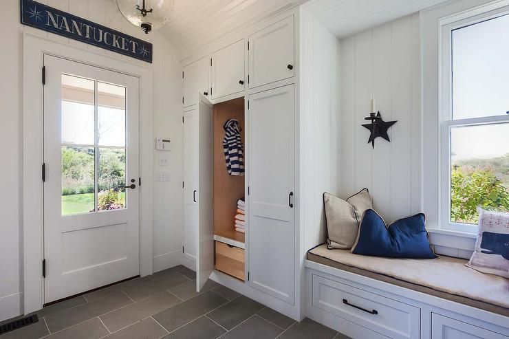 Cottage Mudroom Features A Built In Window Seat Lined With
