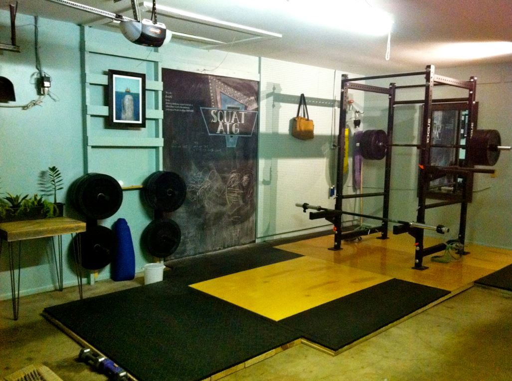 Garage gym olympic platform rack and weights all you need