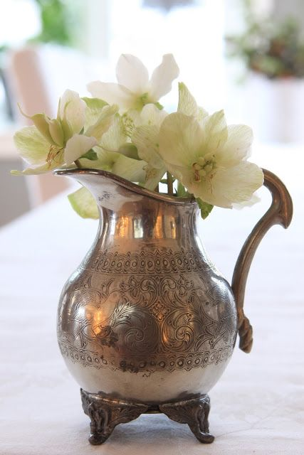 A vintage pitcher and a few flowers make a classy centerpiece