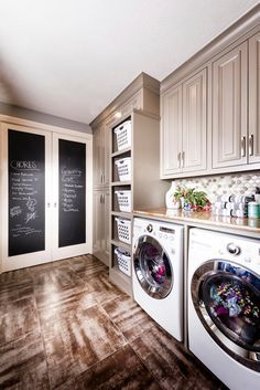 Laundry Room Tan Cabinets Rustic Flooring Chalk Board Double Doors Basket