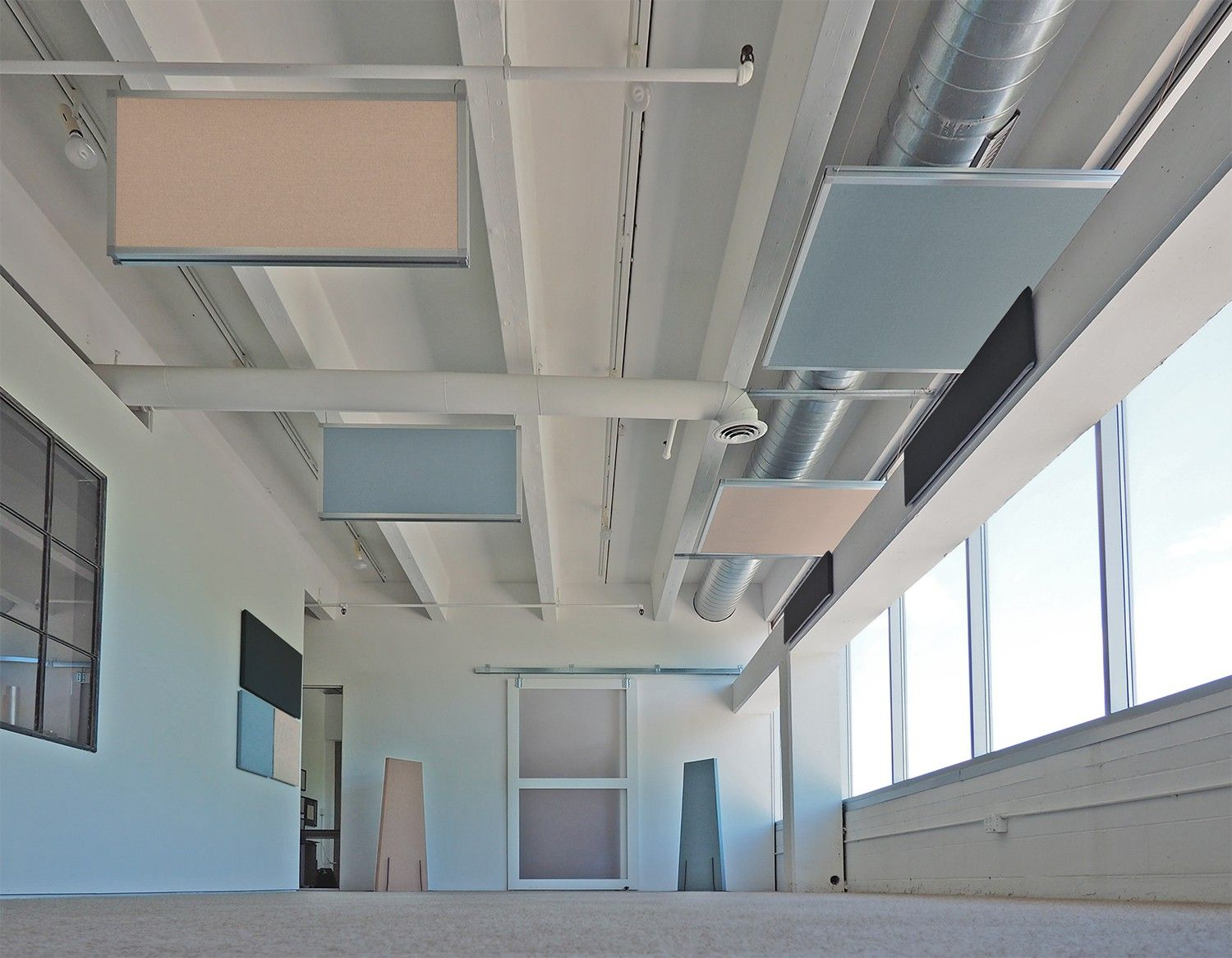 Our hanging acoustic panels create a unique, modern look while ...