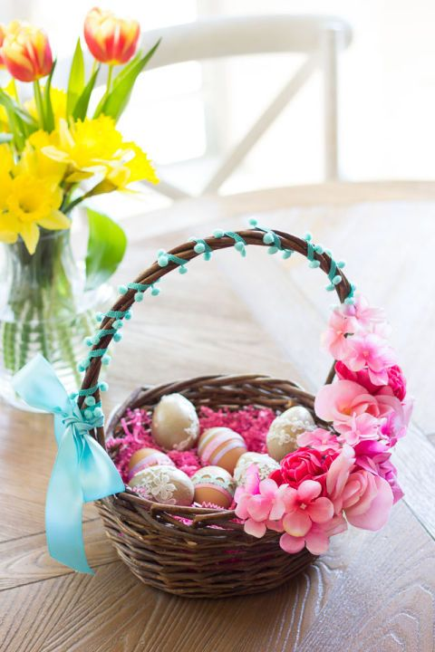 Give a basket from the thrift store new life by decorating it with silk flowers and some fun ribbon.  Get the tutorial from Design Improvised