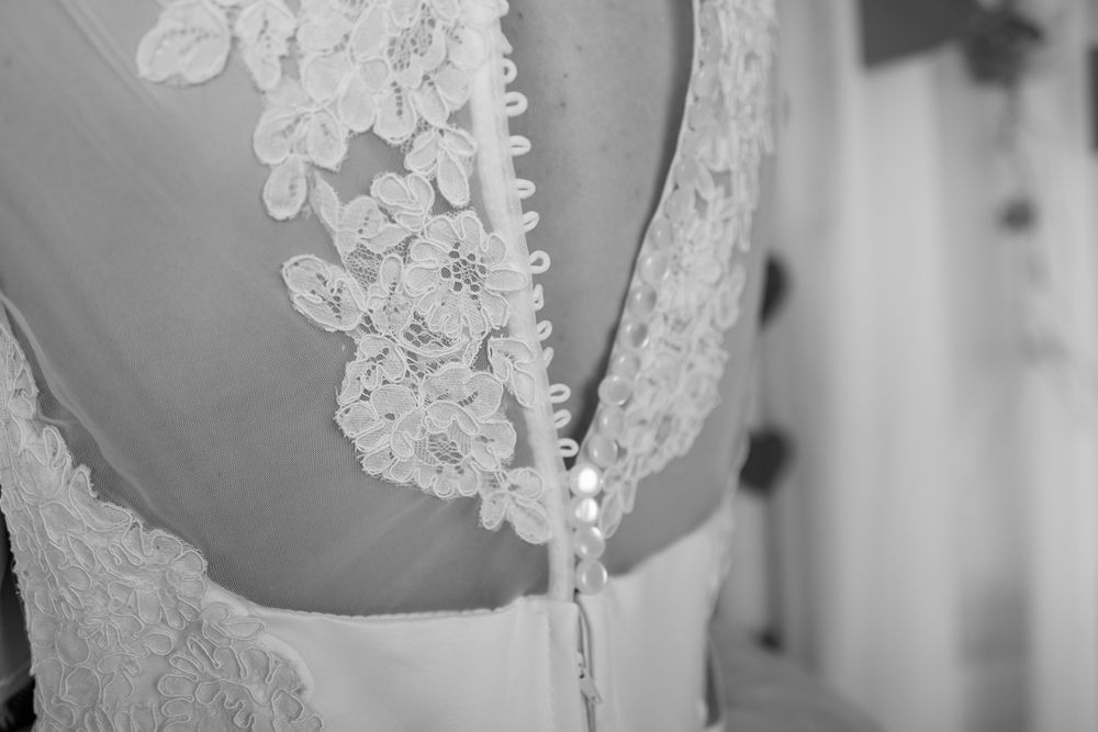 Lace applique Wedding dress with buttons.