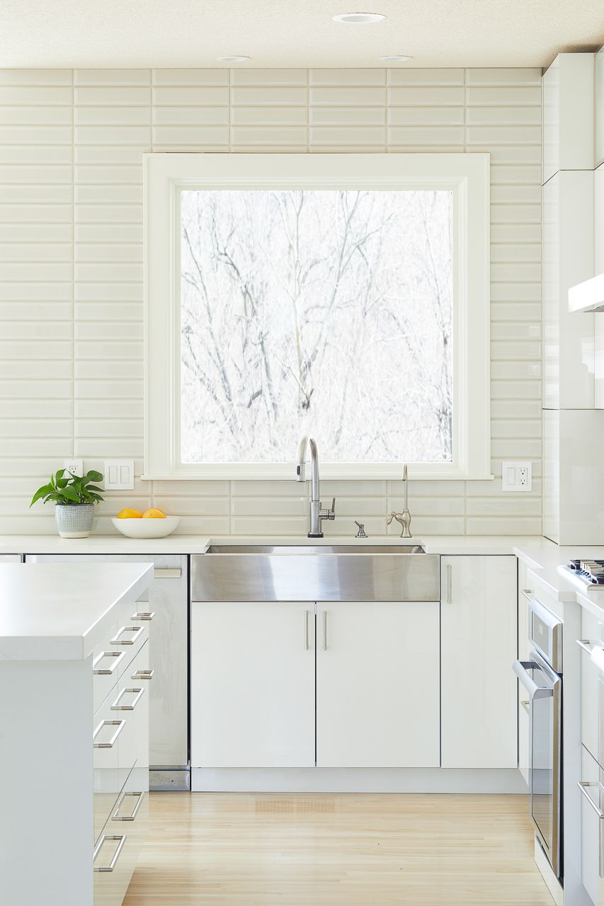 A Dramatic White And Gray Modern Kitchen Remodel