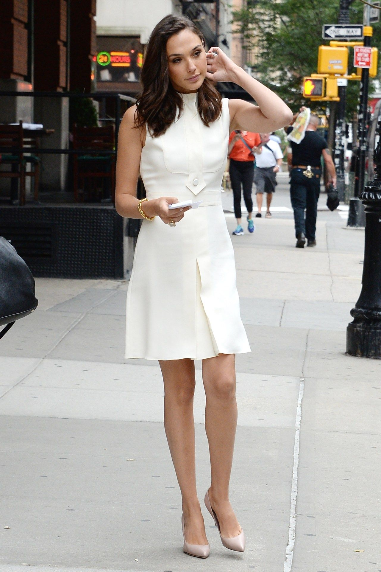 Gal Gadot wearing all white with nude pumps street fashion www.jserene.com