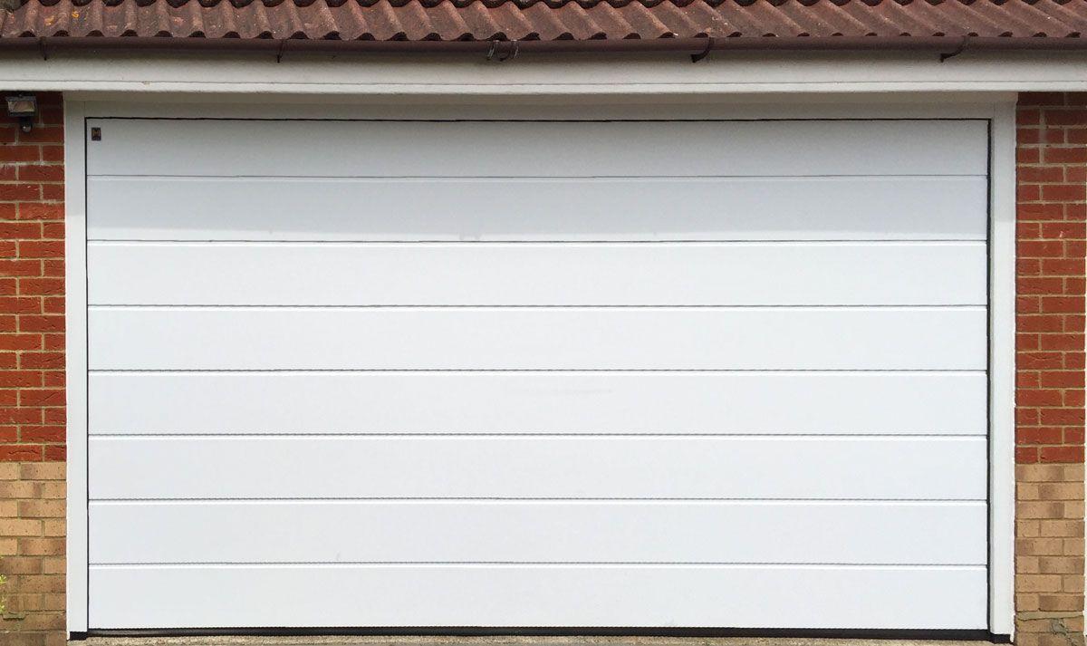 Hormann M Ribbed Sectional Garage Door In Woodgrain Anthracite Grey Garagedoor Garage Doors Sectional Garage Doors Garage Door Styles