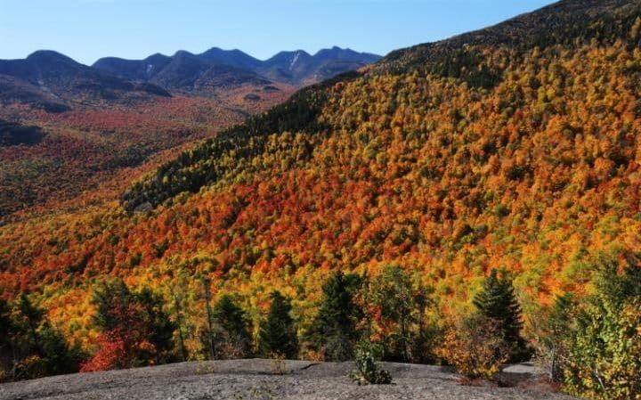 Fall foliage changes colours near Three Brothers Mountain in New York's Adirondack Park in Keene Valley, NewYork.