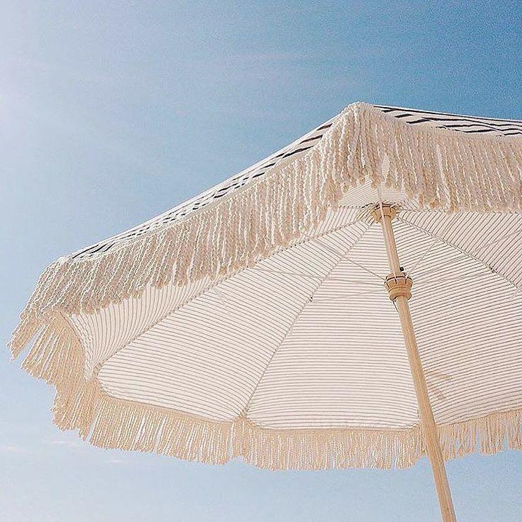 in the shade - fringe beach umbrella