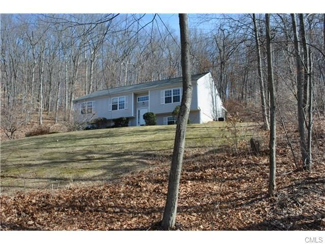 List Price: $314,900 - 3 bedroom, 2.5 bathroom raised ranch conveniently located to both Route 25 & Exit 11 on I84. Open floor plan. Living Room has large window & a vaulted ceiling. Newer Kitchen features cherry cabinetry, stainless steel appliances & granite counter tops. Large island offers storage as well as additional space for eating, homework or meal prep. Master BR suite has walk-in closet and a full bathroom with a shower. Finished lower level offers many uses. Quick close possible.