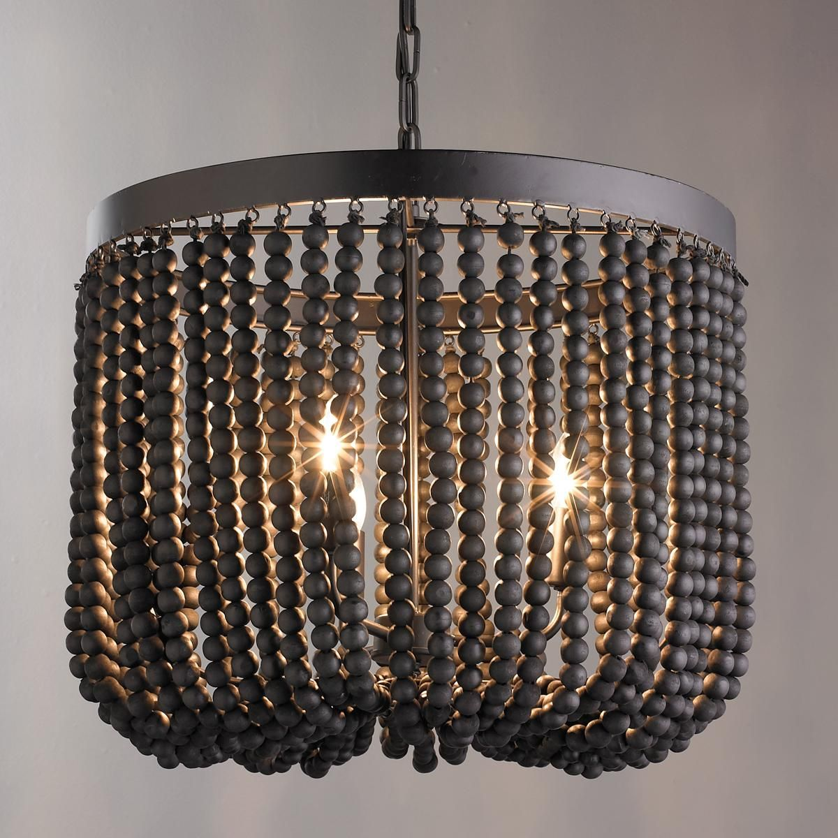 Wood Beaded Draped Chandelier Black Wood Painted Beads Drape From A Metal Frame To Create This Un Wood Bead Chandelier Wooden Bead Chandelier Beaded Chandelier