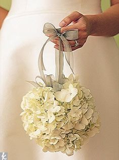 The flower girls will carry pomander balls of ivory hydrangea hanging from charcoal ribbon