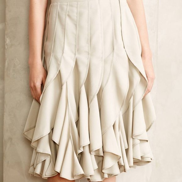 Anthropologie Icefall Skirt Varun Bahl M 6 NWOT Brand new without tag.  Size 6.  Sold out everywhere!  Vertical layers of silky waves fall from waist to knee on Varun Bahl's softly hued skirt, in a departure from the every day ruffle. Anthropologie Skirts Midi