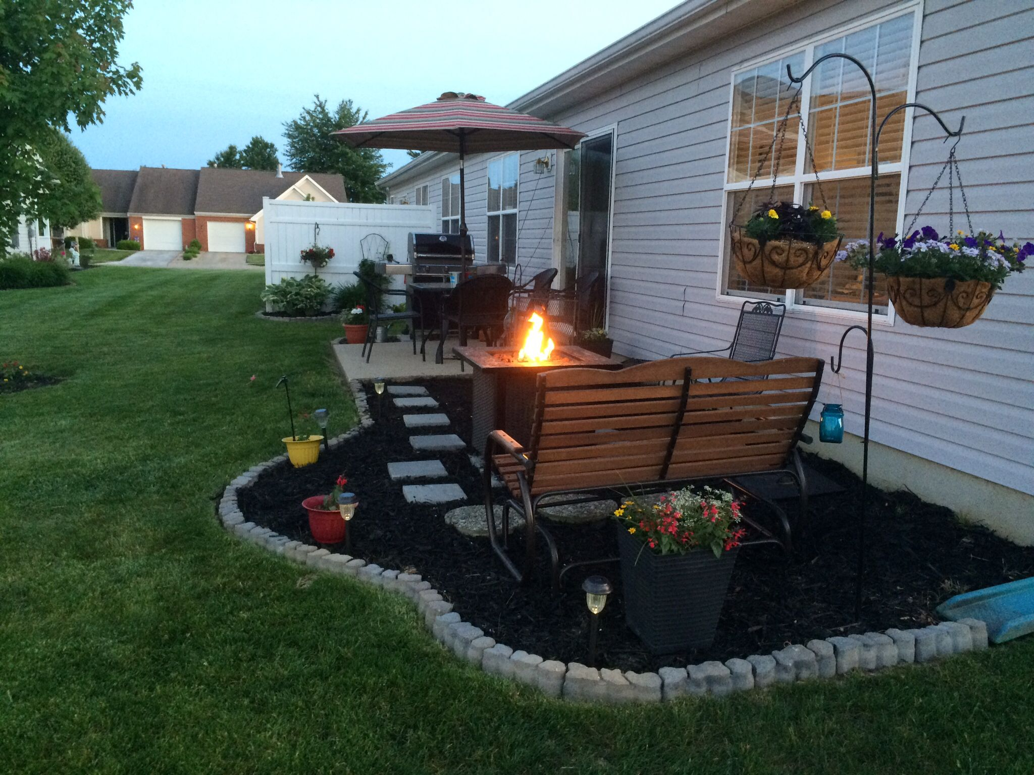 Low cost patio extension, using mulch, paver steps, and