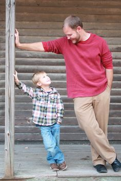 Caleb and his step dad... Technical: 1. Lighting: Daylight. 2. Composition: Vertical and horizontal creates linear crosses. 3. Rule of thirds crop creates diagonals with the eyes! Aesthetic: 4. 5. Excellent juxtaposition of body sizes. 6. Duplication of body position adds humorous mimicking. 7. Message: A man to look up to and emulate. 8. A really loving shot. Wonderful Step-father idea!