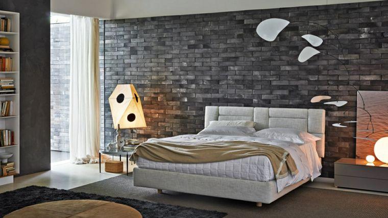 recamaras modernas con decoracion de piedra en la pared Dormitorio
