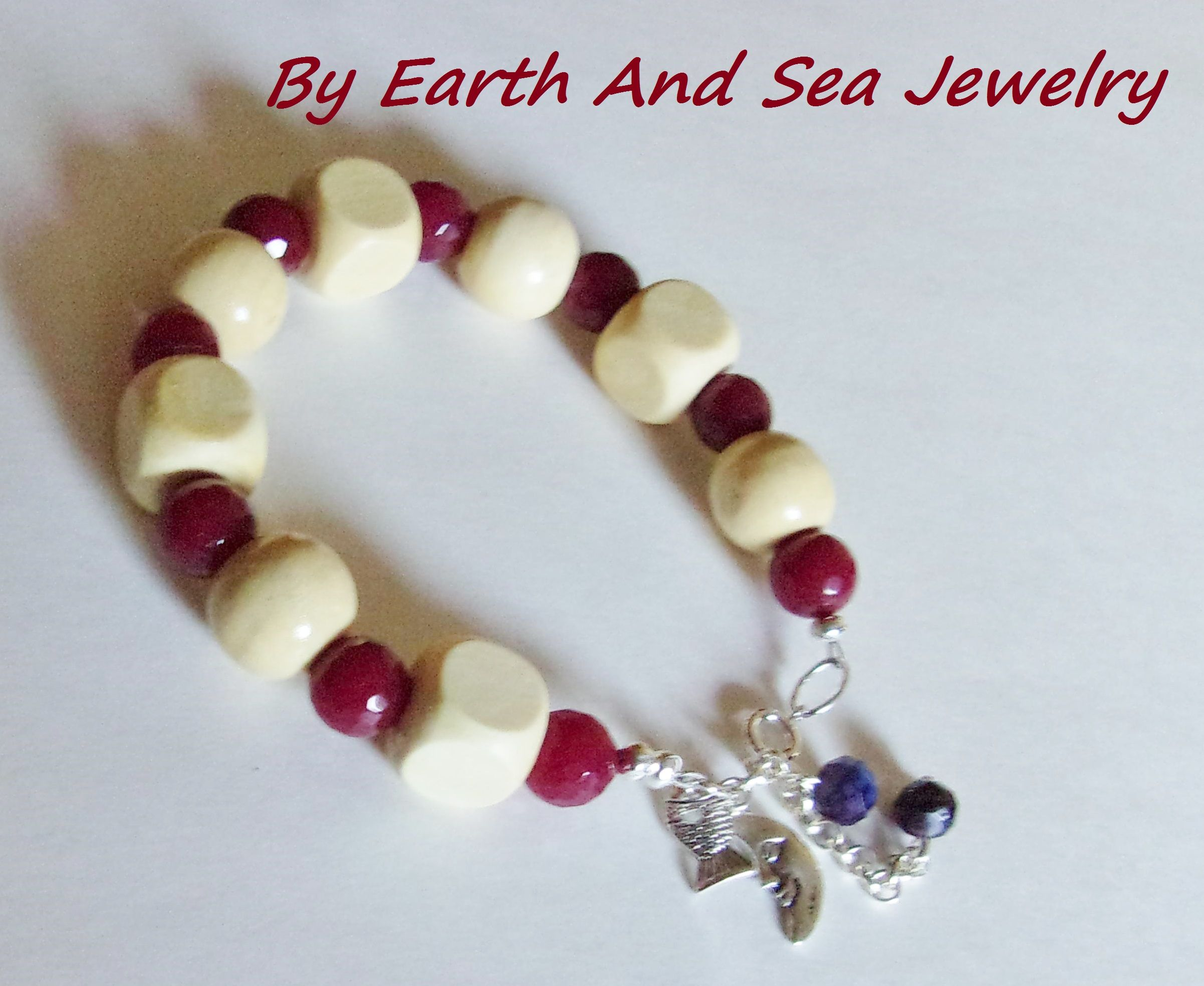 This is a beacy look in my opinion. Very light and flashy but not too flashy. I used large white wood round and square, Dark Red Faceted Ruby Gemstone 10x14mm and Chinese Red/White/Blue Splatter Crystals Rhondelle Beads 8x6mm. I attached a silver rolo ... - $19.50