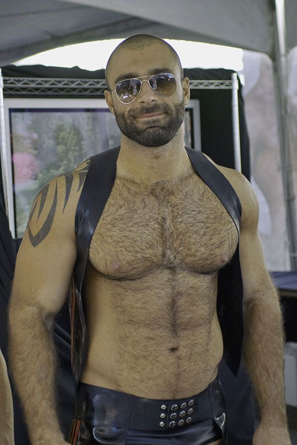 Gay musclemen wearing masks