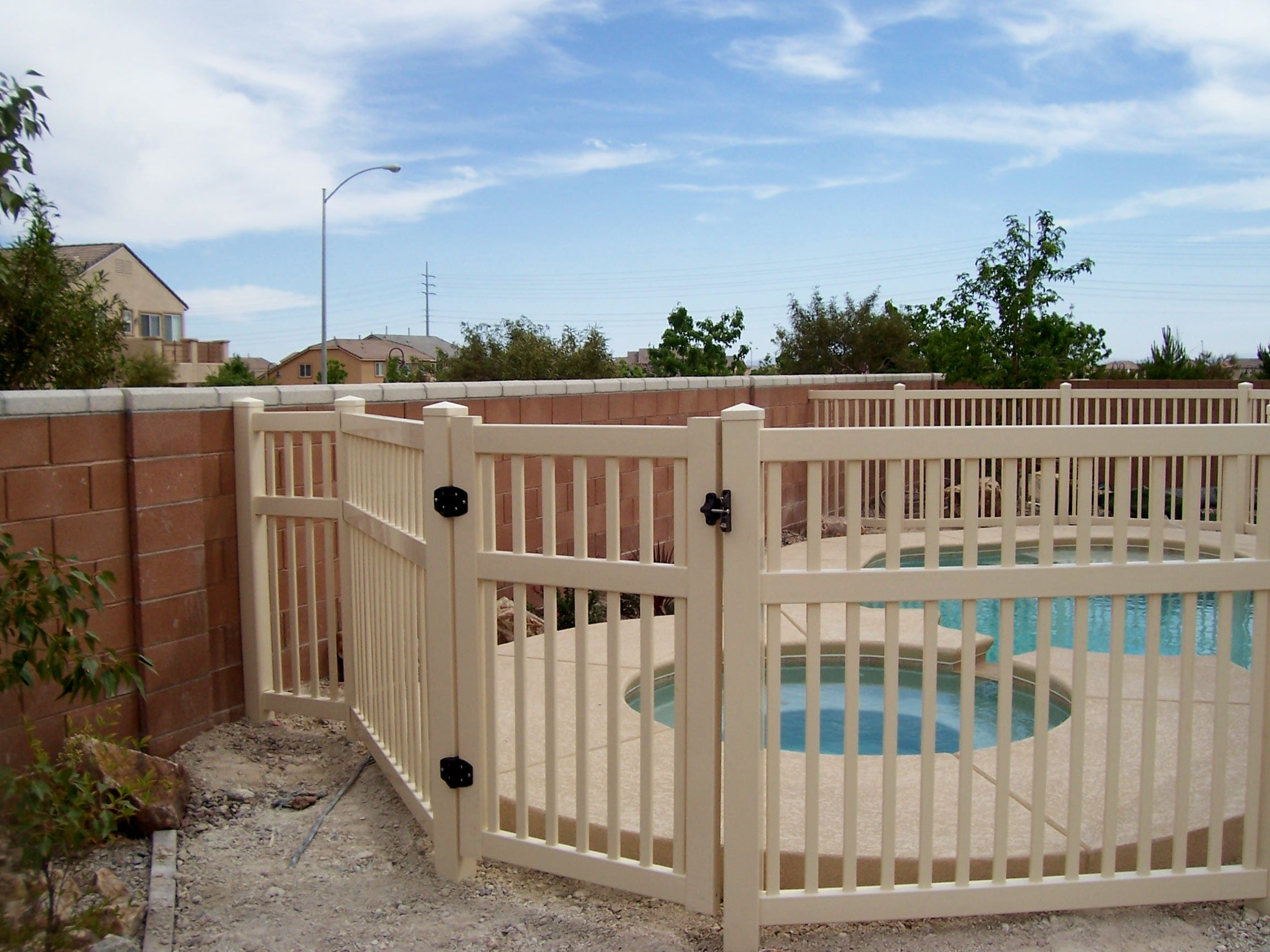 Custom vinyl pool fence installed by Divine About the