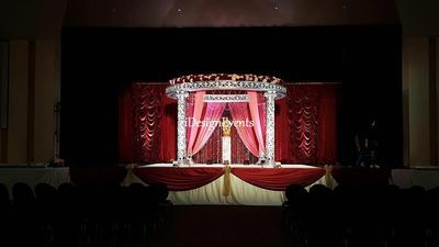 Silver Mandap with Marsala Burgundy and Peach Flowers for
