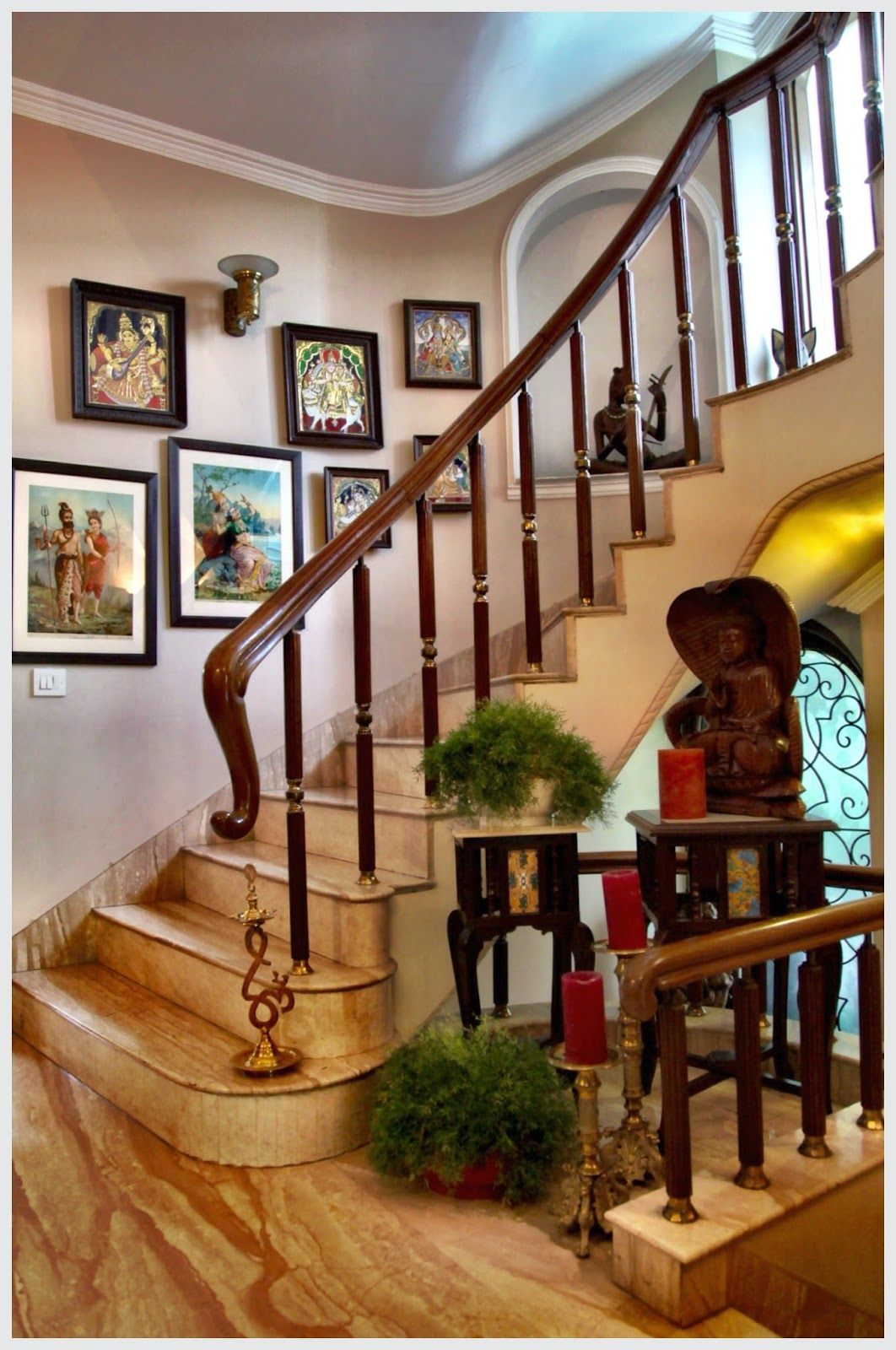 Lining the walls of the stairway are Ravi Varma Lithographs and
