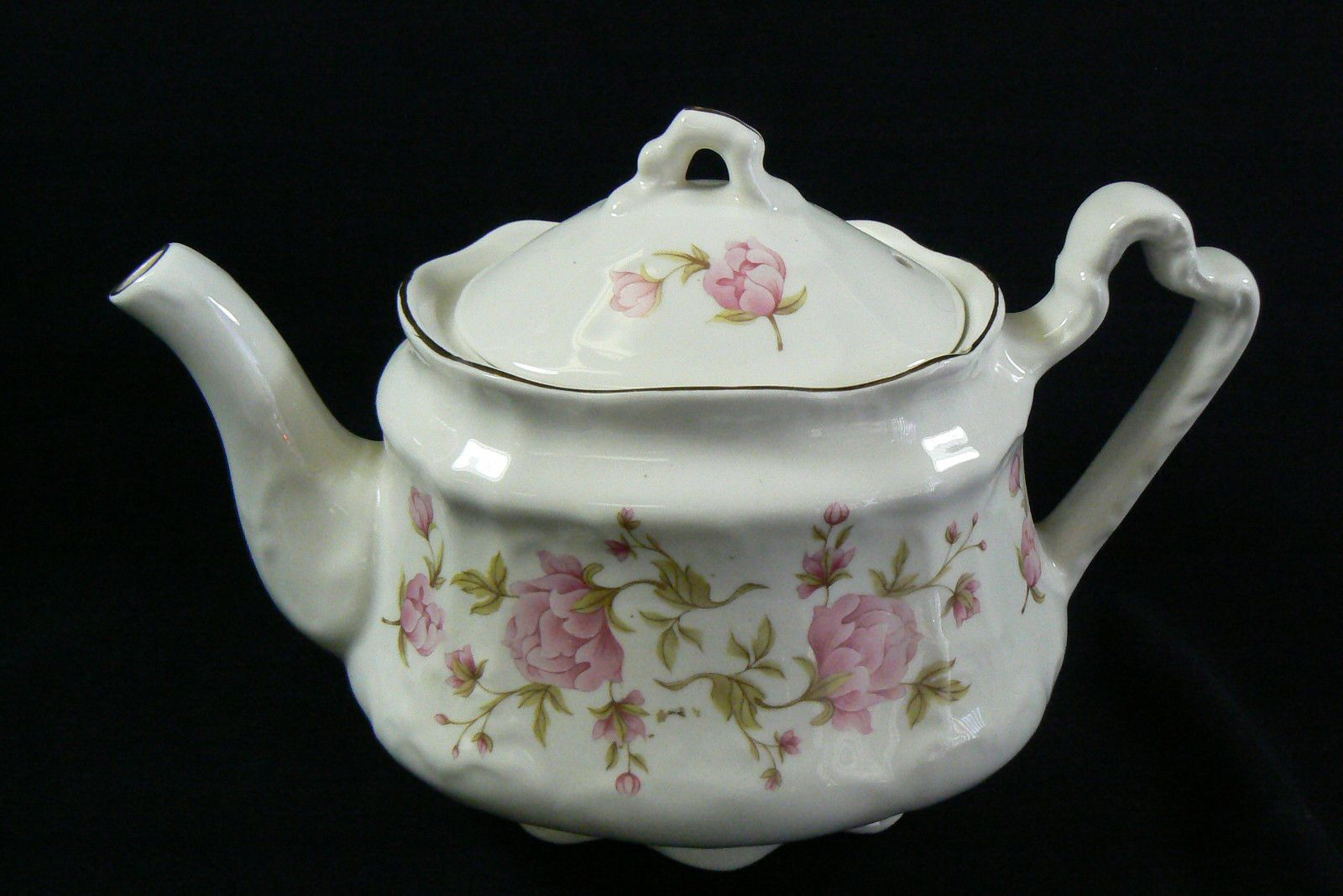 gray teapot background pink leaves yellow vintage