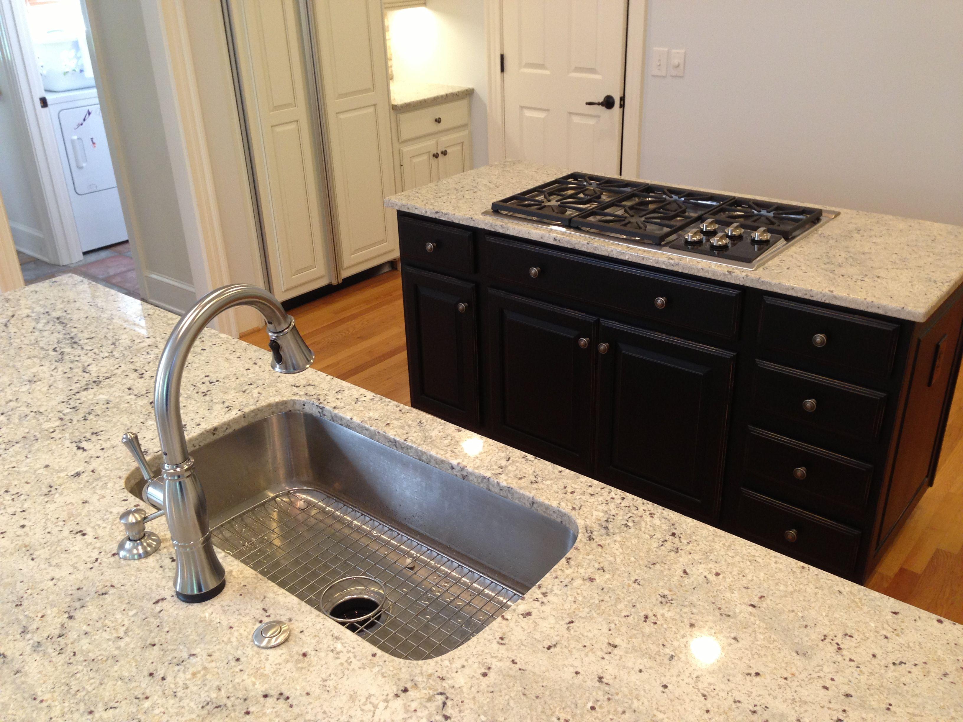 Single bowl Kohler Untertone sink + Delta touch activated faucet