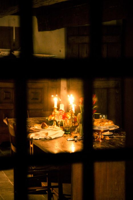 Looking through night windows at a candlelight dinner inside....