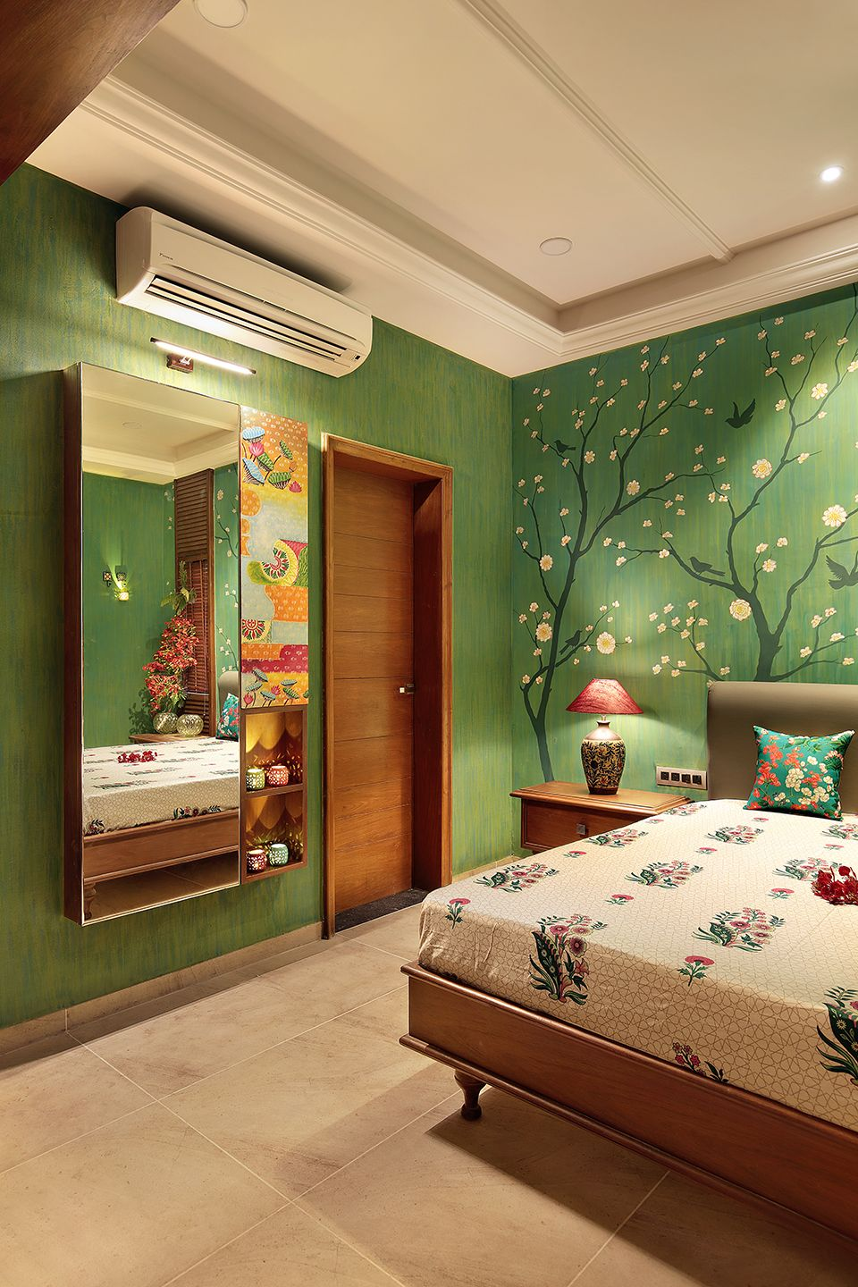 Hand painted bedroom wall with forest scene in moss green