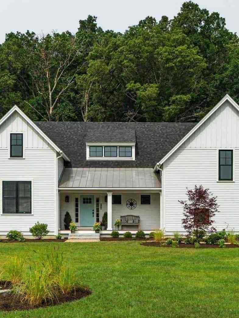 Modern Eclectic Farmhouse With Delightful Design Features In Michigan Farmhouse Style House Colonial Style Homes Eclectic Farmhouse