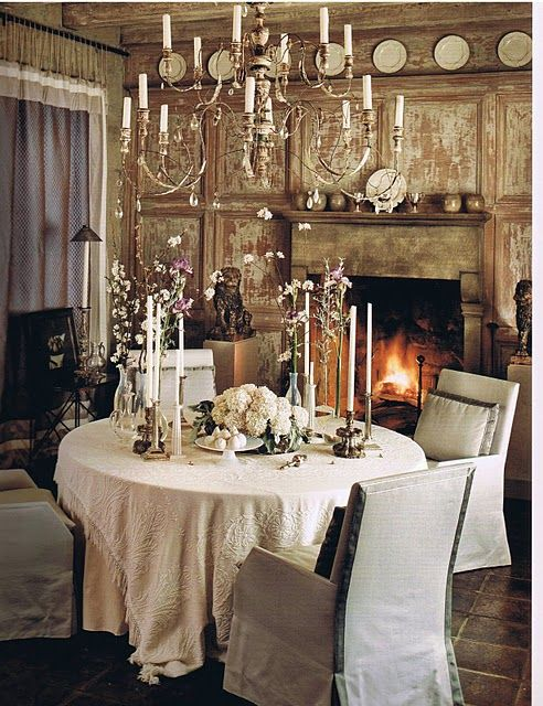 How romantic to have a candle lite dinner in a dining room with a fire place...John Saladino design