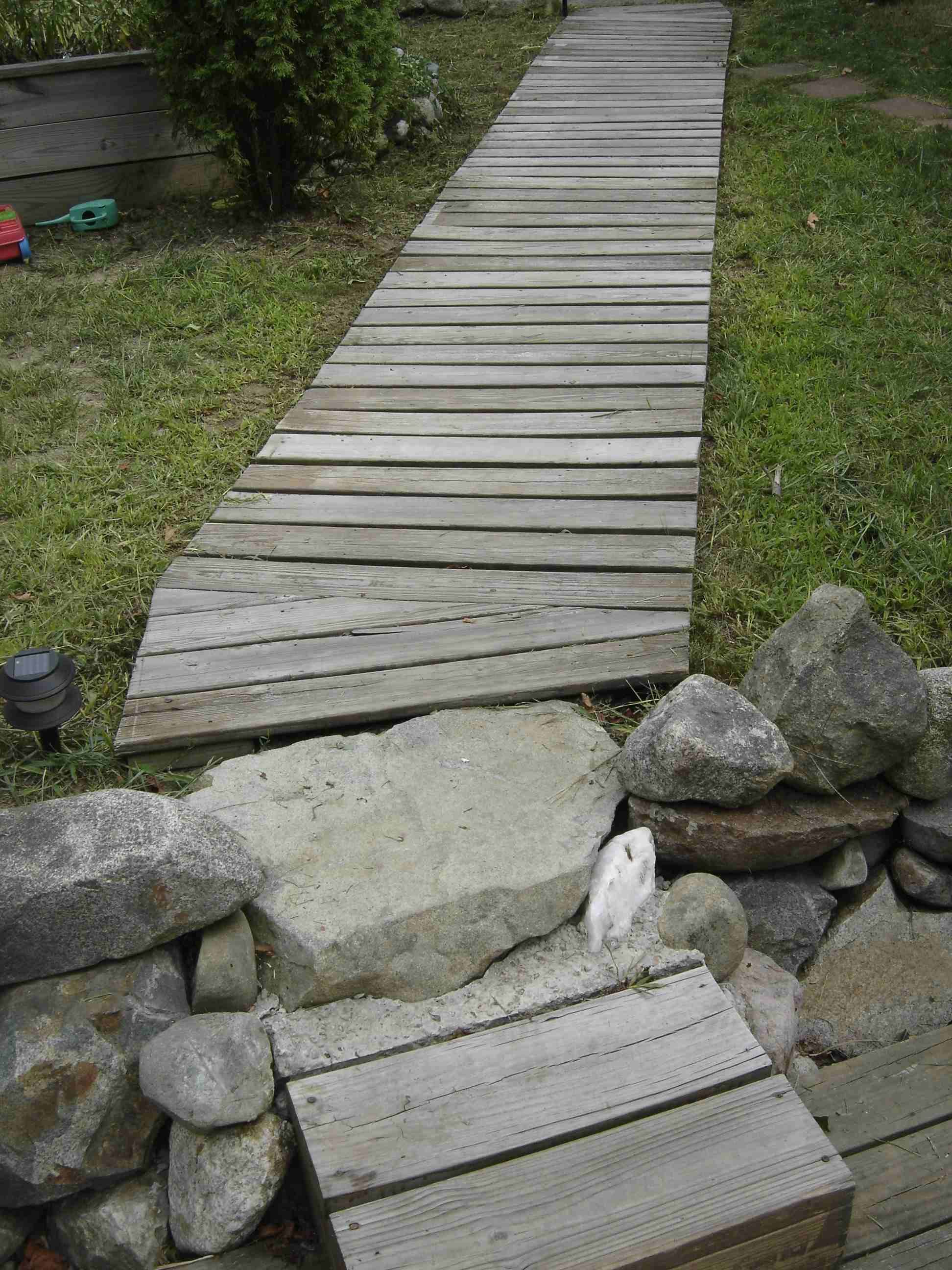 Diy wood walkway who needs concrete when you have free pressure treated lumber outdoor for Pressure treated wood for garden