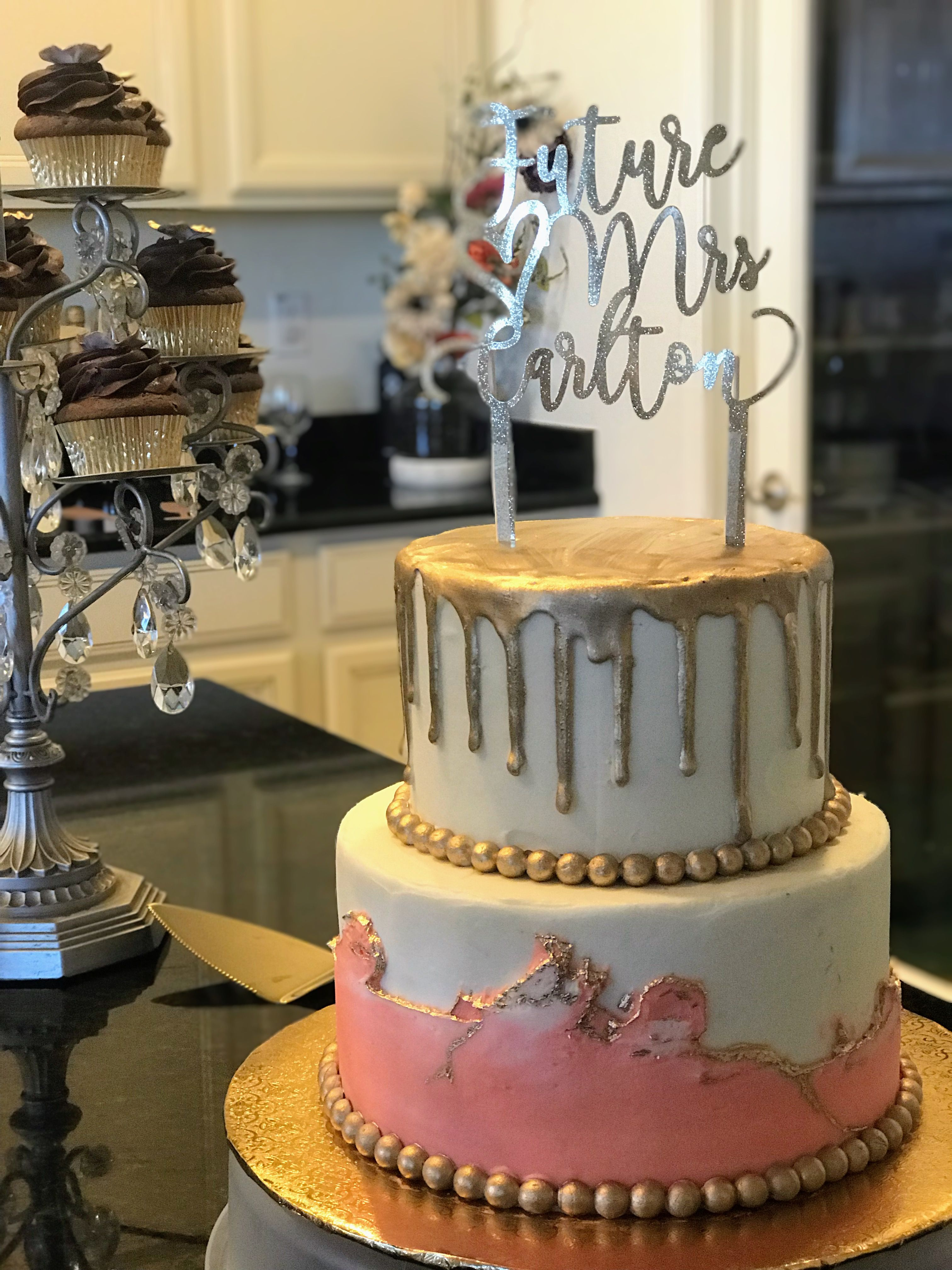 White and pink buttercream with gold drip and gold fault ...