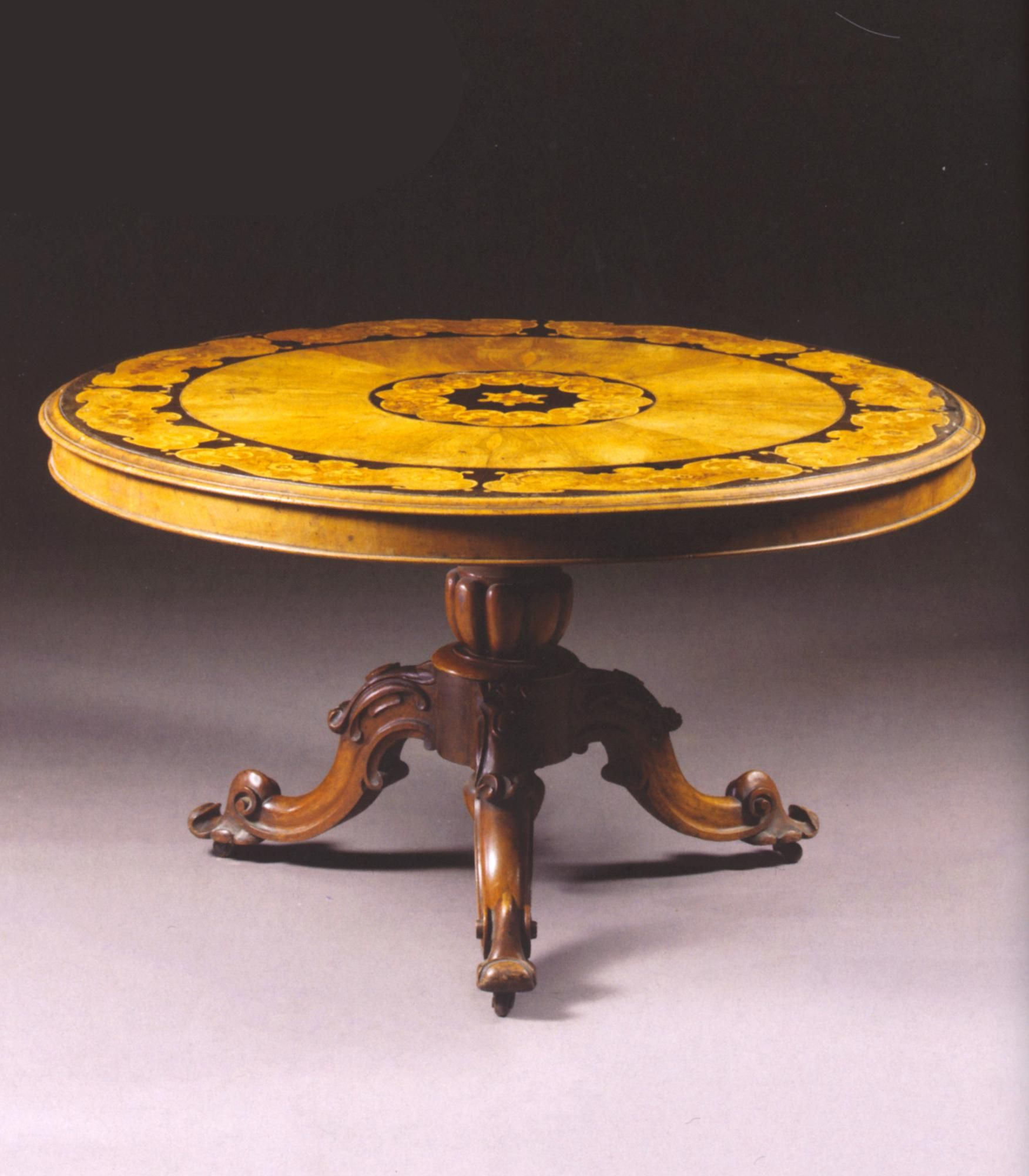 A Victorian Walnut and Marquetry Centre Table  English, Circa 1860.