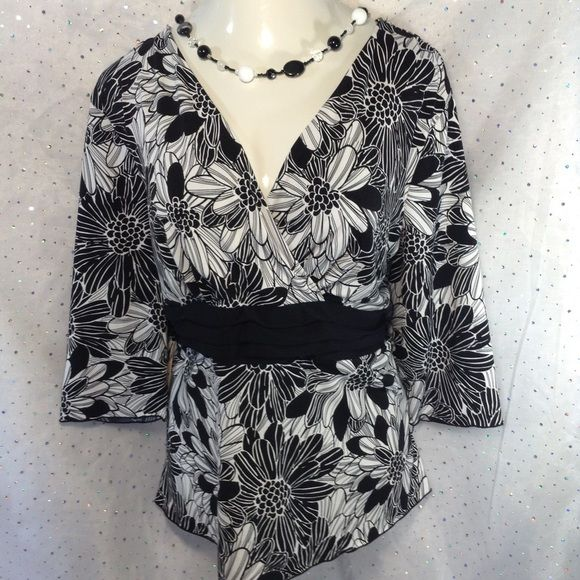 CJ Banks 2X Faux Wrap Top Gorgeous!  Flattering!  Sexy!  Whether at work or a night out, you will look amazing in this stretchy flowy floral top.  Bodice is lined.  94% polyester, 6% spandex. CJ Banks Tops Tunics