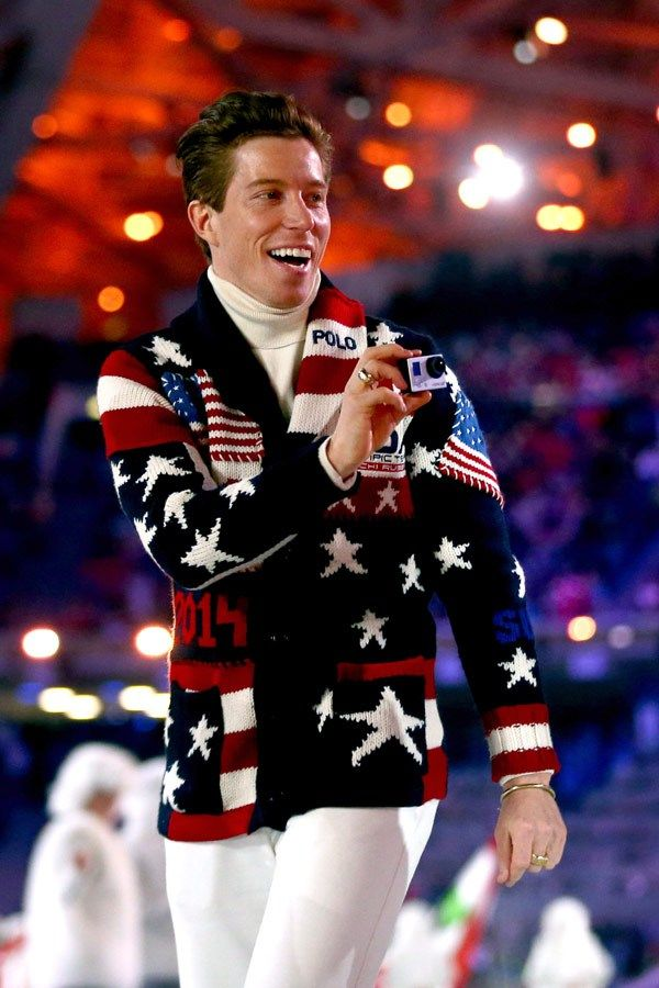 Shaun White taking photos as the USA athletes march in during opening ceremonies
