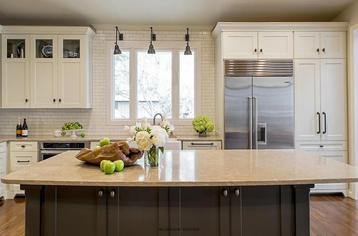 White And Gray Kitchen Features Shaker Cabinets Adorned With Bronze Oval S Paired Gold Countertops A Linear Tile Backsplash